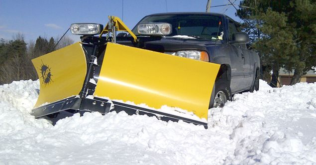 Truck plowing snow